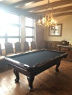 Pool Table that converts to a dining table in the Presidential Suite.